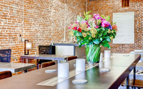 3060-Larimer-Conf-Table-Flowers-480x300