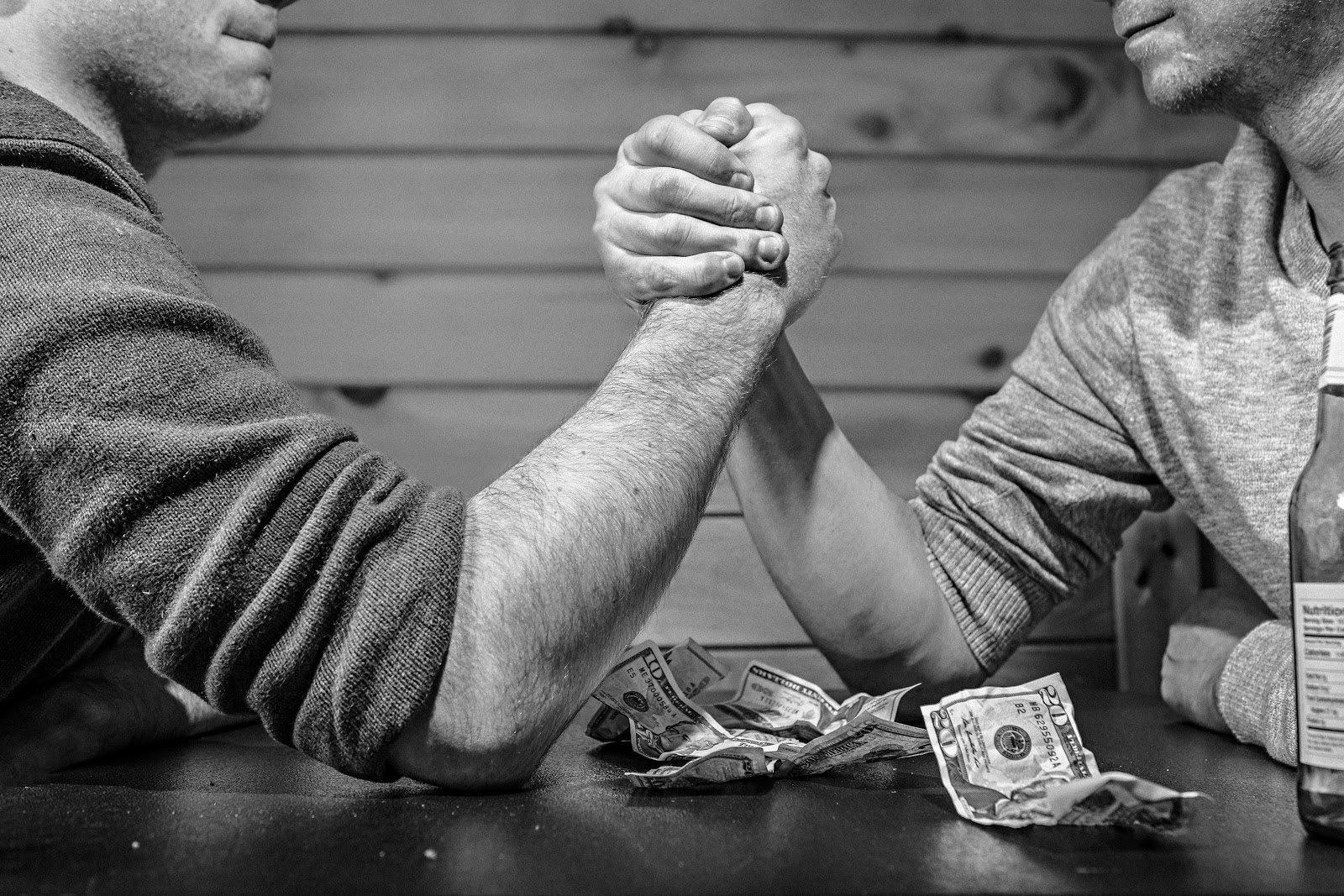 bandit signs article - arm wrestle