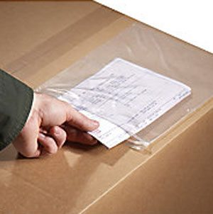 a guy's hand inserting information sheet inside a plastic envelop attached to a shipment box