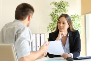 woman interviewing an applicant