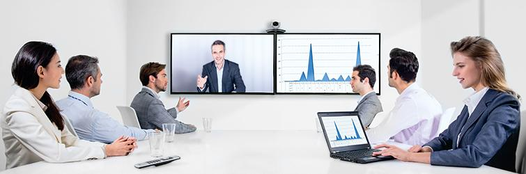 Photo Showing a Meeting with a Presenter joining on Screen 1 and Their Presentation Slides on Second 2 in Zoom
