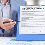 insurance policy being pointed to on clipboard