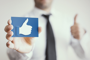 man holding a LIKE icon