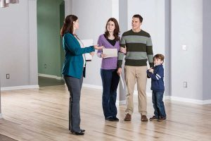 family looking for an apartment, talking to an agent