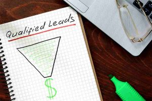 qualified leads written on notebook