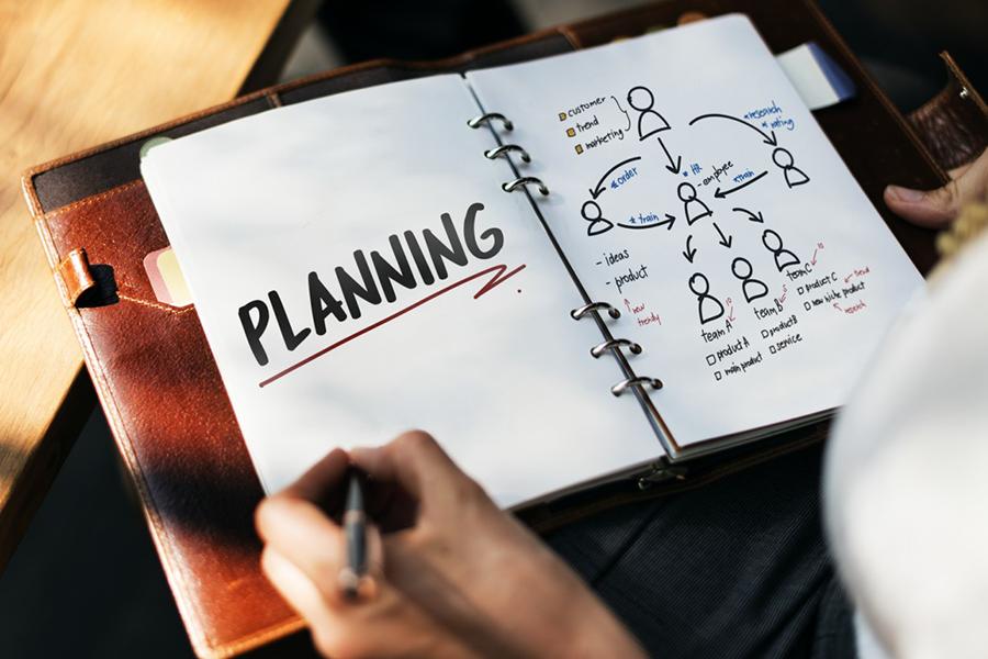 woman writing a plan