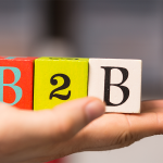Hand holding blocks that say B2B