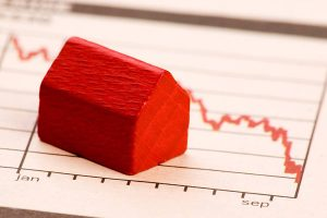 miniature red house on a graph