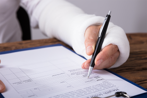injured worker filling out health insurance form