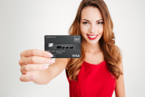Woman holding a business credit card
