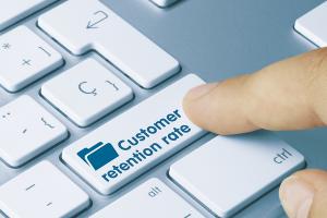 Customer retention rate written on the keyboard key.