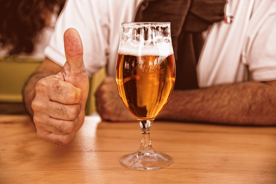 thumbs up with a glass of beer
