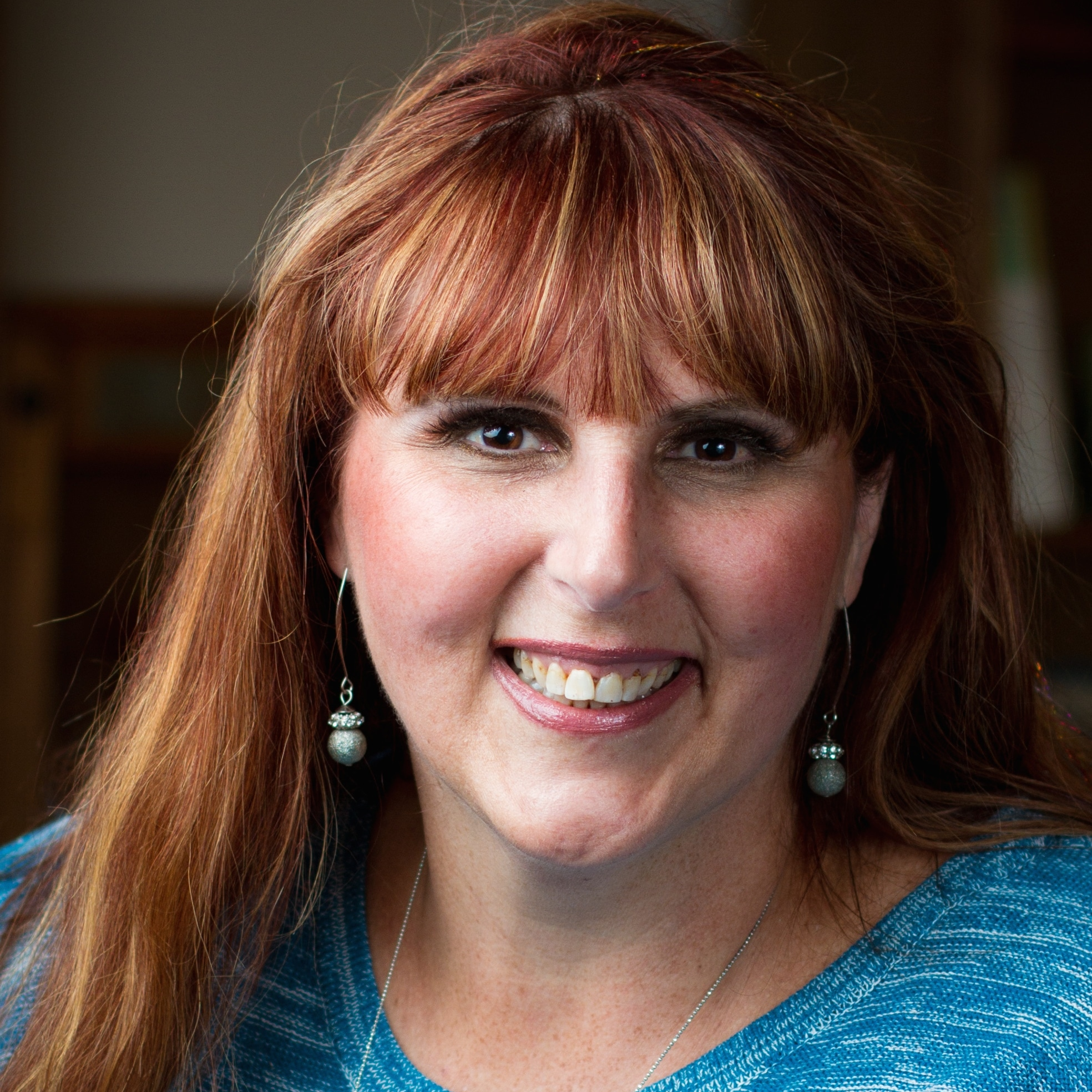 headshot of Erika Taylor Montgomery, CEO, Three Girls Media Inc.