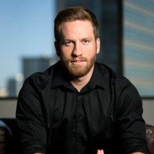 headshot of Nathan Wade, Managing Editor at WealthFit Money