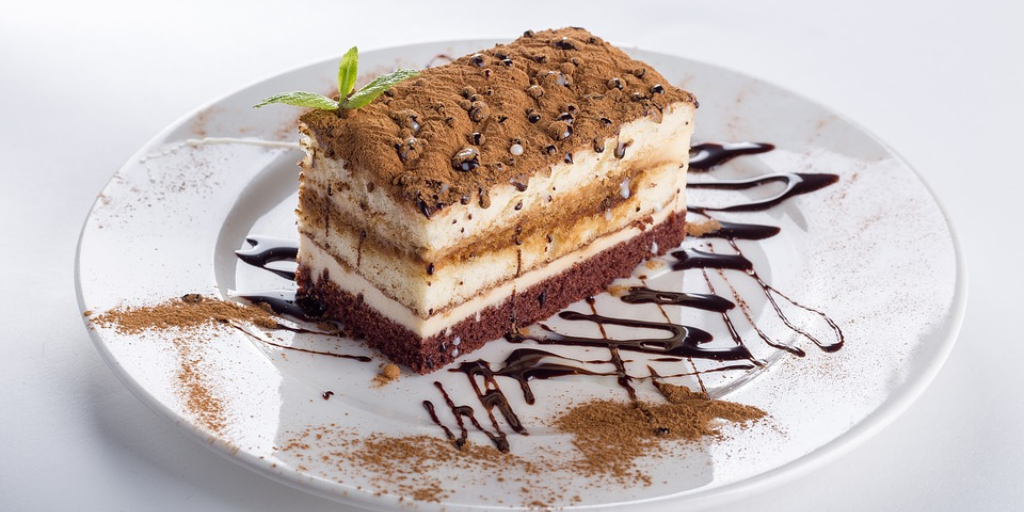 a decorated slice of layer cake on a white plate