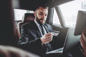 man checking credit card details