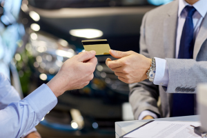 businessman gives a credit card to another person