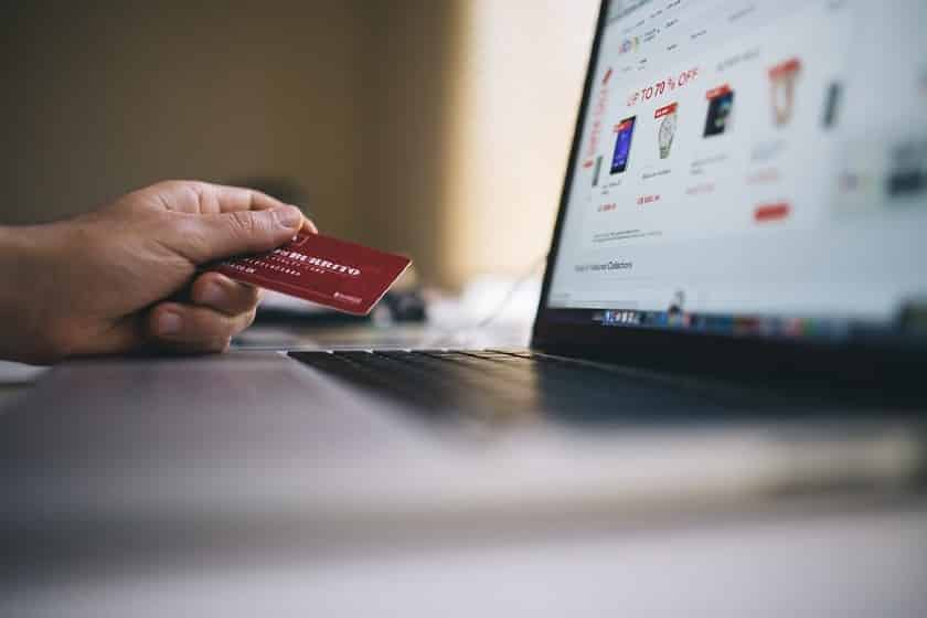 hand holding credit card shopping online