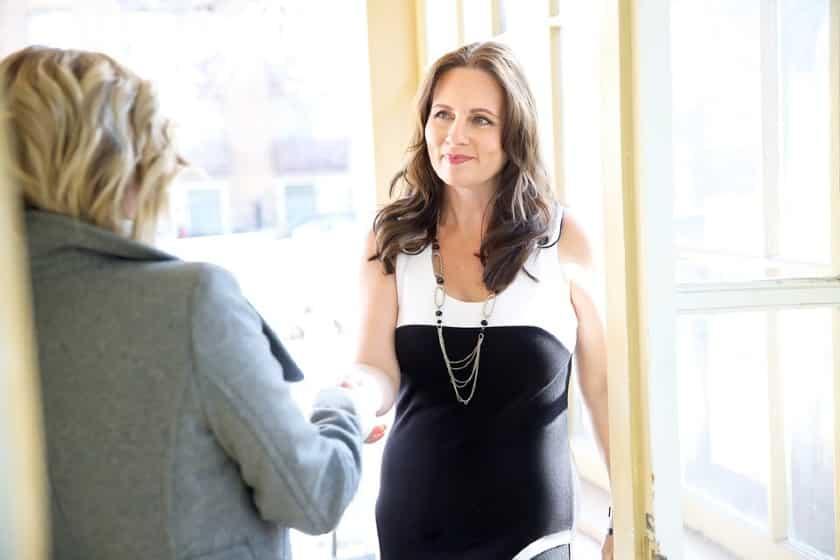 businesswomen shake hands