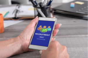 hand holding phone with recruitement app on screen