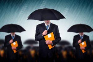 Three men in black suit using black umbrellas