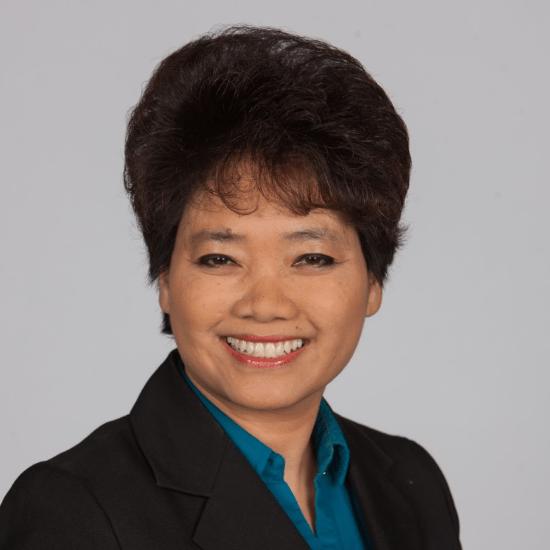 headshot of Dr. Emily Letran - dental practice loans