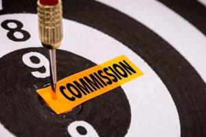 Dart arrow pinning Commision on a dart board