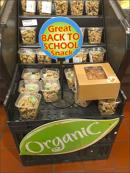 a granola display of in-store signage that says great back to school snack