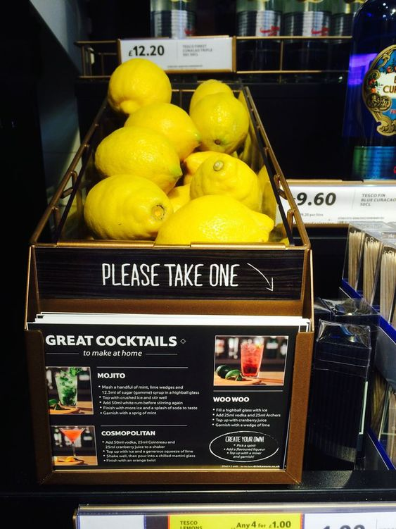a lemon display that also offers a cocktail recipe card using the lemons