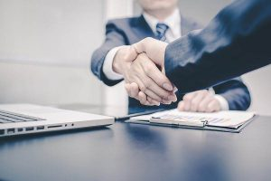 two businessman shakes hands