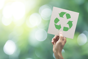 Holding a Paper with a Recycle Logo