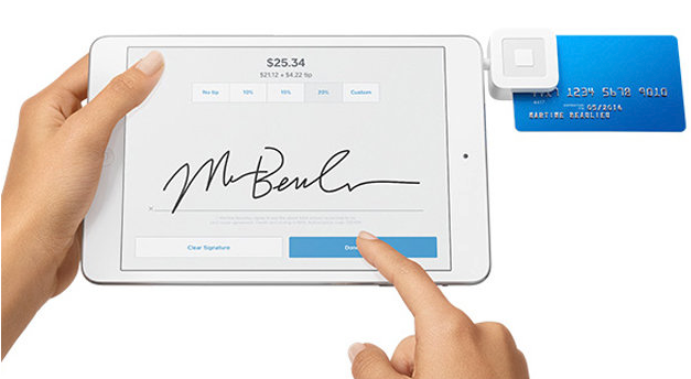 Mockup of someone using Square's mobile POS card reader on a tablet