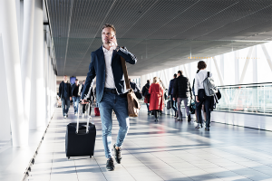 man holding luggage on call
