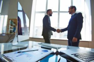two brokers having hand shake