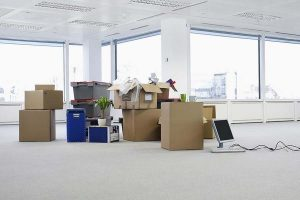 Moving Boxes And Furniture In Office