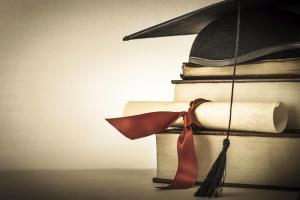 graduate cap and diploma in books