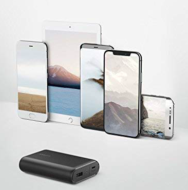 Anker PowerCore 1000 portable charger shown with different Apple devices
