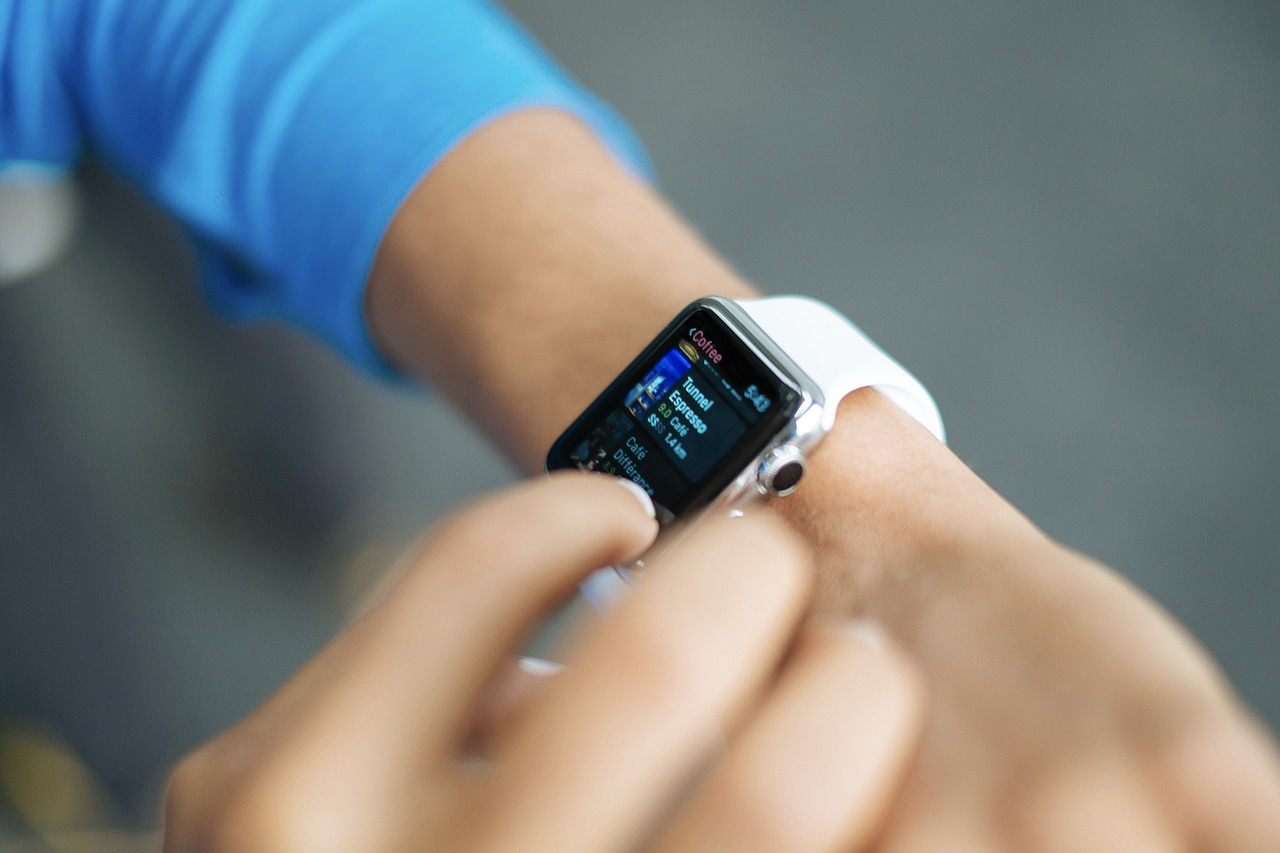 a photo of a user interacting with a smartwatch