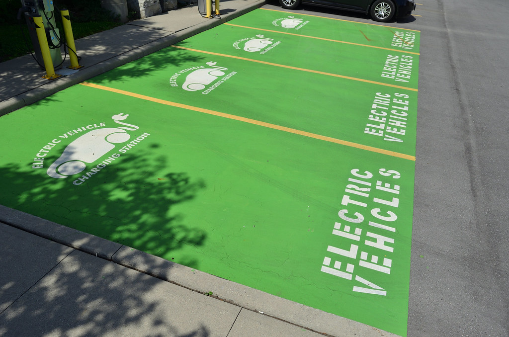 a photo of parking spaces with electric charging stations