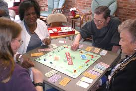 Four people playing Monopoly
