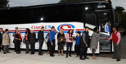 Group tour on Coach USA bus