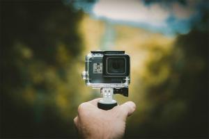holding camera for vlogging