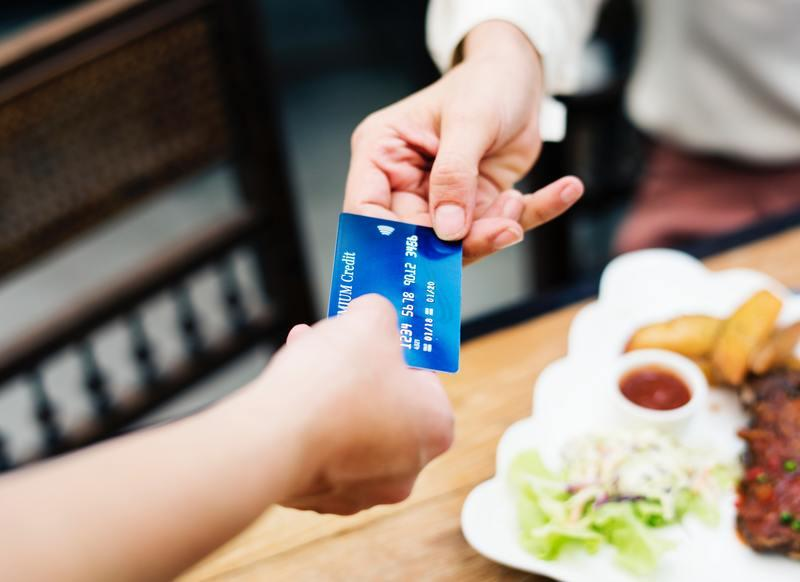 credit card handed over for transaction
