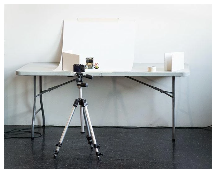 camera on tripod taking product shot on white background