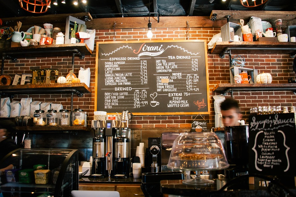 Coffee shop counter with menu infront