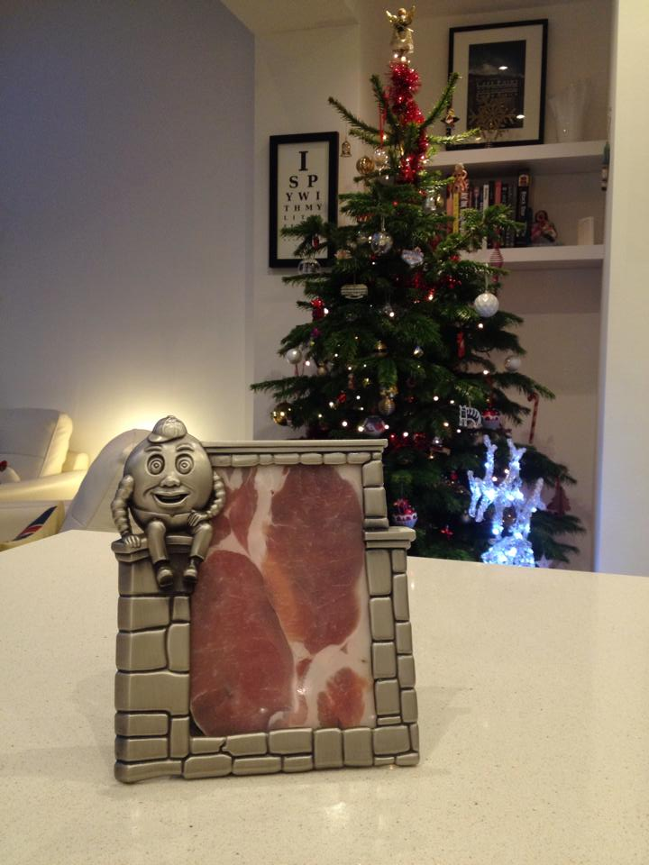 a slice of bacon in a picture frame on a kitchen counter