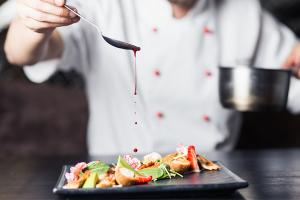 chef cooks preparing meat in the restaurant kitchen