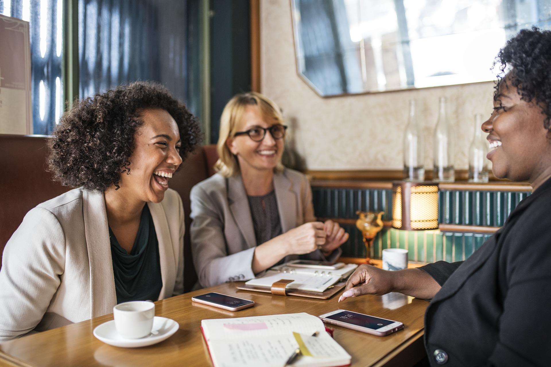 Three women having conversation