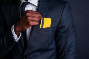 man placing credit card on his pocket