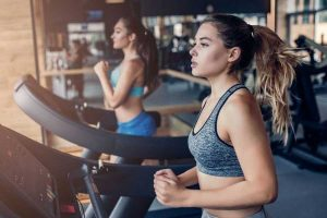 women doing exercise at gym